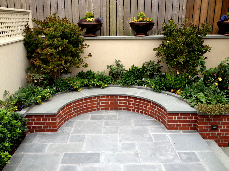 Finished Blue Stone Patio And Curved Bench.