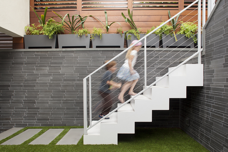 Carport design makes for creative outdoor living space for Exterior steel stair design